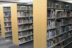 Bookshelves in the NorQuest College library.